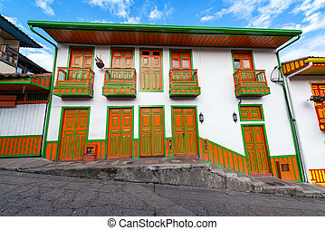 Orange and Green Colonial Building