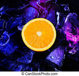 Orange and ice  - Orange slice among ice cubes