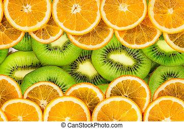 Orange and kiwi slices texture background
