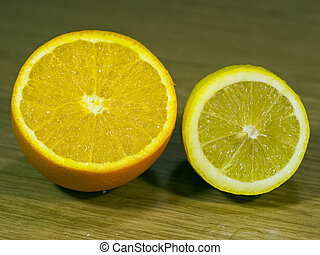 Orange and lemon on a wooden surface