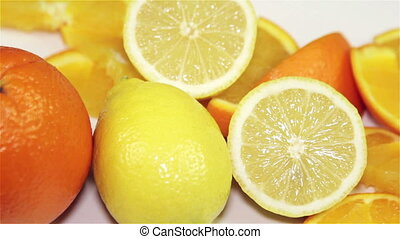 orange and lemon rotation on the table, close-up