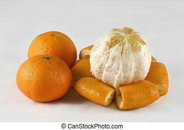 Orange and tangerine - A peeled orange and tangerines