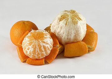 Orange and tangerine - Peeled orange and tangerines.