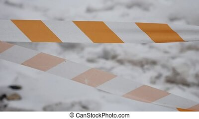 orange and white, striped protective tape protects fresh...