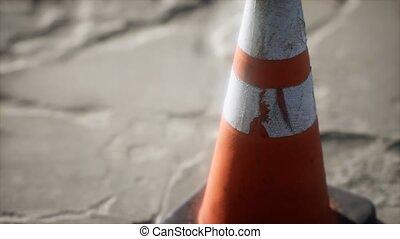 orange and white striped traffic cone