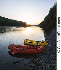 Orange and yellow packrafts rubber boats