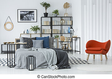 Orange armchair in bedroom interior
