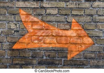 Orange arrow on the wall