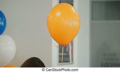 Orange balloon indoors closeup shot