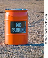 Orange barrel with warning sign