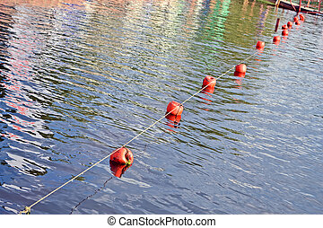 orange barrier buoy line on water, environment