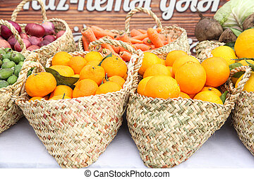 Orange baskets with other vegetables in the grocery