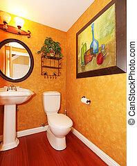 Orange bathroom with large painting.