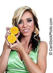 Orange - Beautiful woman with a slice of a fresh and juicy...
