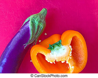 Orange bell pepper and eggplant with text space