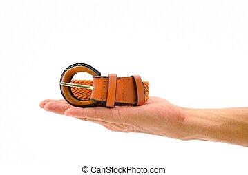 Orange belt roll for woman on hand
