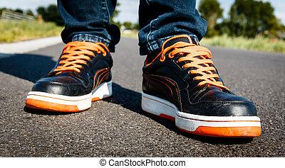 Orange black sport shoes, on the move