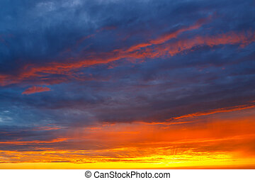 orange, blue and yellow colors sunset sky