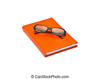 Orange book and glasses, isolated on white background