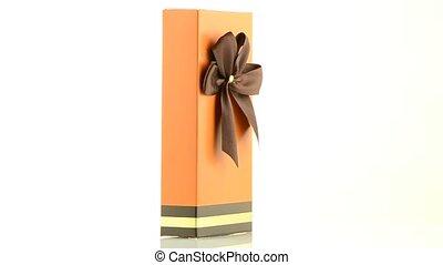 Orange box with gold bow on white background.
