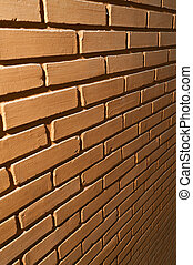 Orange brick wall square format in perspective view