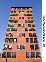 Orange Building Exterior towards Blue sky