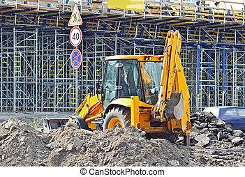 Orange bulldozer on bridge road construction site