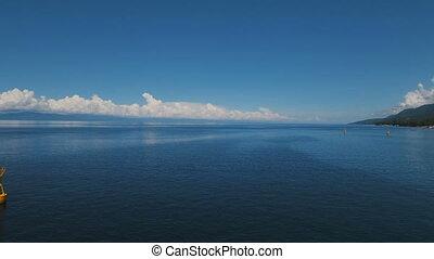 Orange buoy in the sea. - Orange buoy in the blue sea on a...