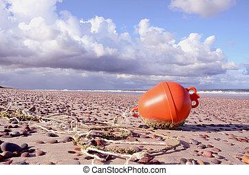 orange buoy on the sea beach