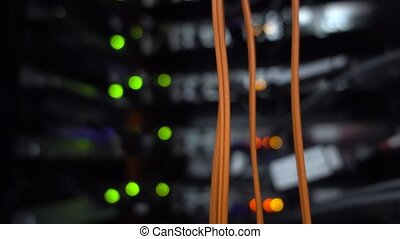 Orange cable server rack. Blink blurred background