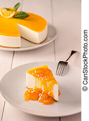 Orange Cake in white dish on the white wood table