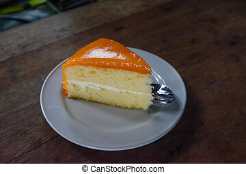 Orange cake on wooden background