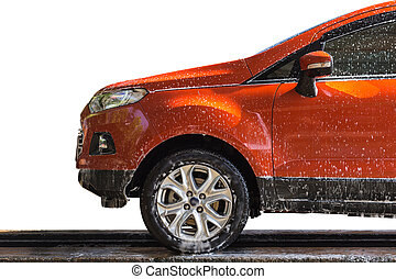 Orange car with white soap on the body in car care shop....