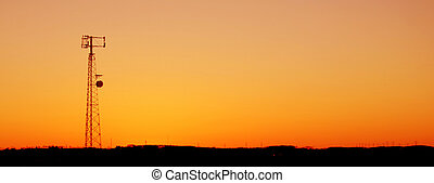 Orange Cell Tower Si - A cell phone tower silhouette in the...