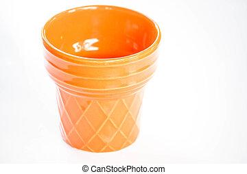 Orange ceramic plant pot isolated on white background