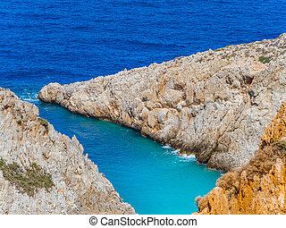Orange cliffs and beautiful blue sea - Crete, Greece