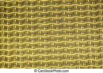 Orange Close up image of black dash mat with grid cells.