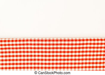 Orange cloth, a kitchen towel with a checkered pattern, on a white background isolated