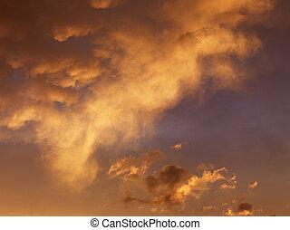 Orange clouds in sky.