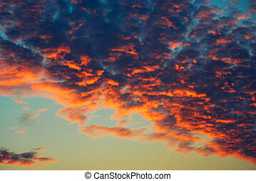 Orange clouds in winter sunset