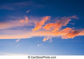 orange clouds on a blue sky at sunset or sunrise
