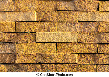 orange color laterite block wall texture