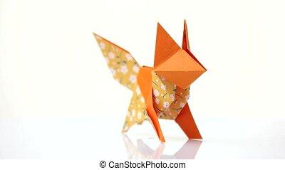 Orange color origami fox. Creative origami animal made from...
