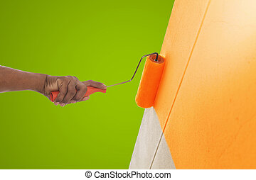 Orange color painting wall with roller
