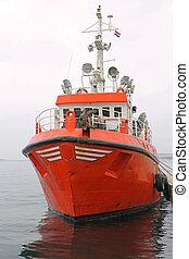 Orange Commercial Fishing Vessel Moored at Dock