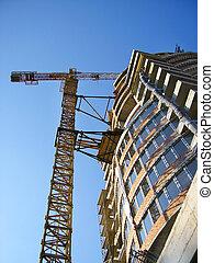 Orange crane build - Tall orange crane constructing a new...