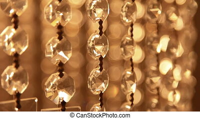 orange crystal chandelier bokeh