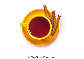 orange cup of tea with cinnamon