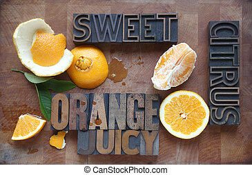 orange cut and peeled with words