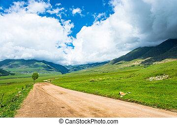 Orange dirt road in the Semenov gorge, Kyrgyzstan.